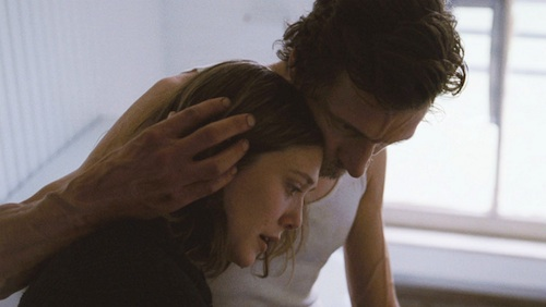 Elizabeth Olsen and John Hawkes in MARTHA MARCY MAY MARLENE