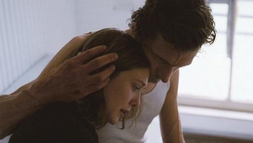 Elizabeth Olsen and John Hawkes in MARTHA MARCY MAY MARLENE