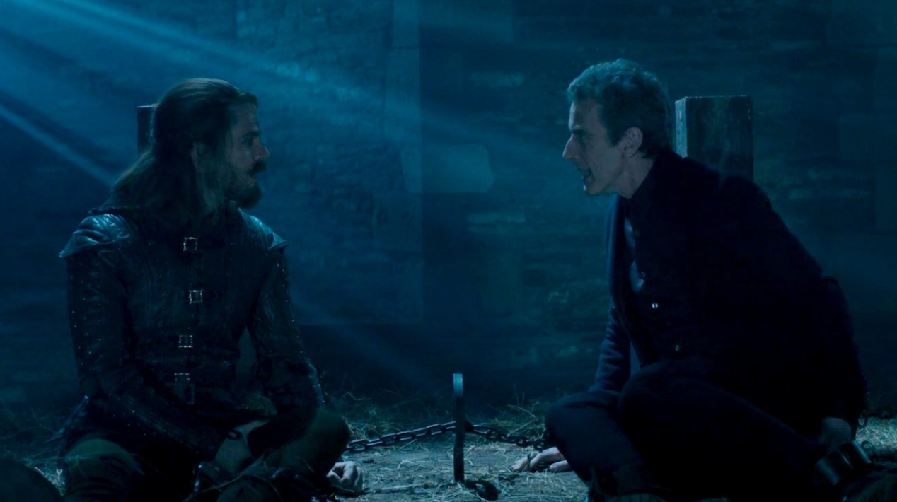 Robin Hood (Tom Riley) and the Doctor (Peter Capaldi) in ROBOT OF SHERWOOD