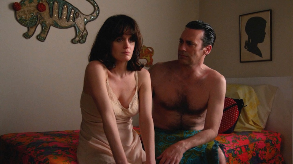 Diana (Elizabeth Reaser) and Don (Jon Hamm) in New Business
