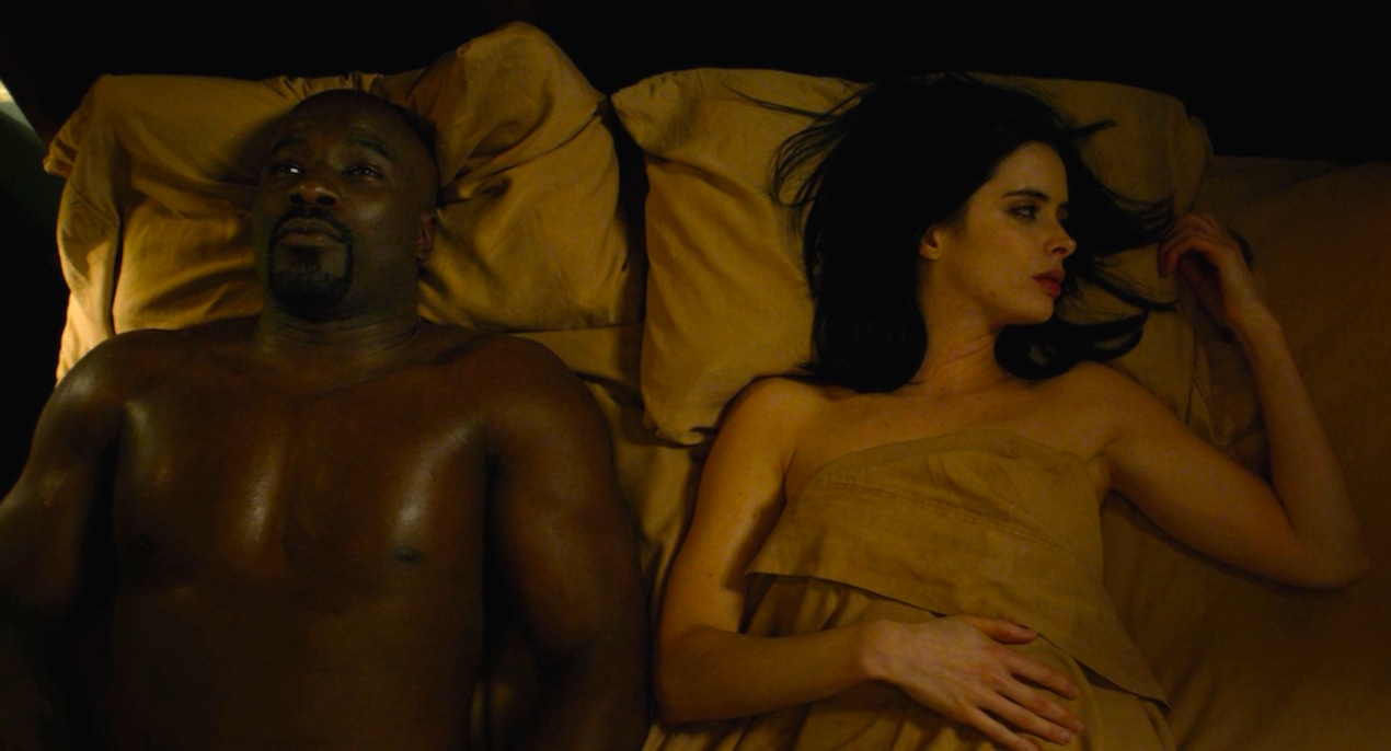 Luke (Mike Colter) and Jessica (Krysten Ritter) in AKA It's Called Whiskey