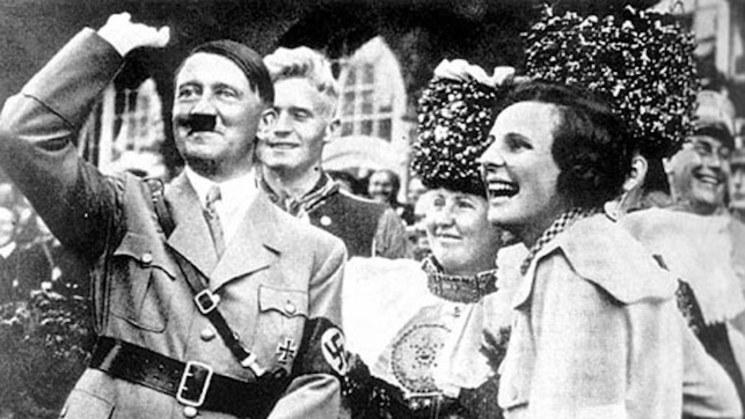 Adolf Hitler and Leni Riefenstahl, on the set of Triumph of the Will. (Image: Mourning the Ancient)