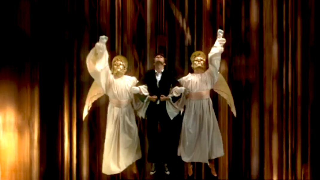 The Doctor (David Tennant), borne aloft by angels, in Voyage of the Damned