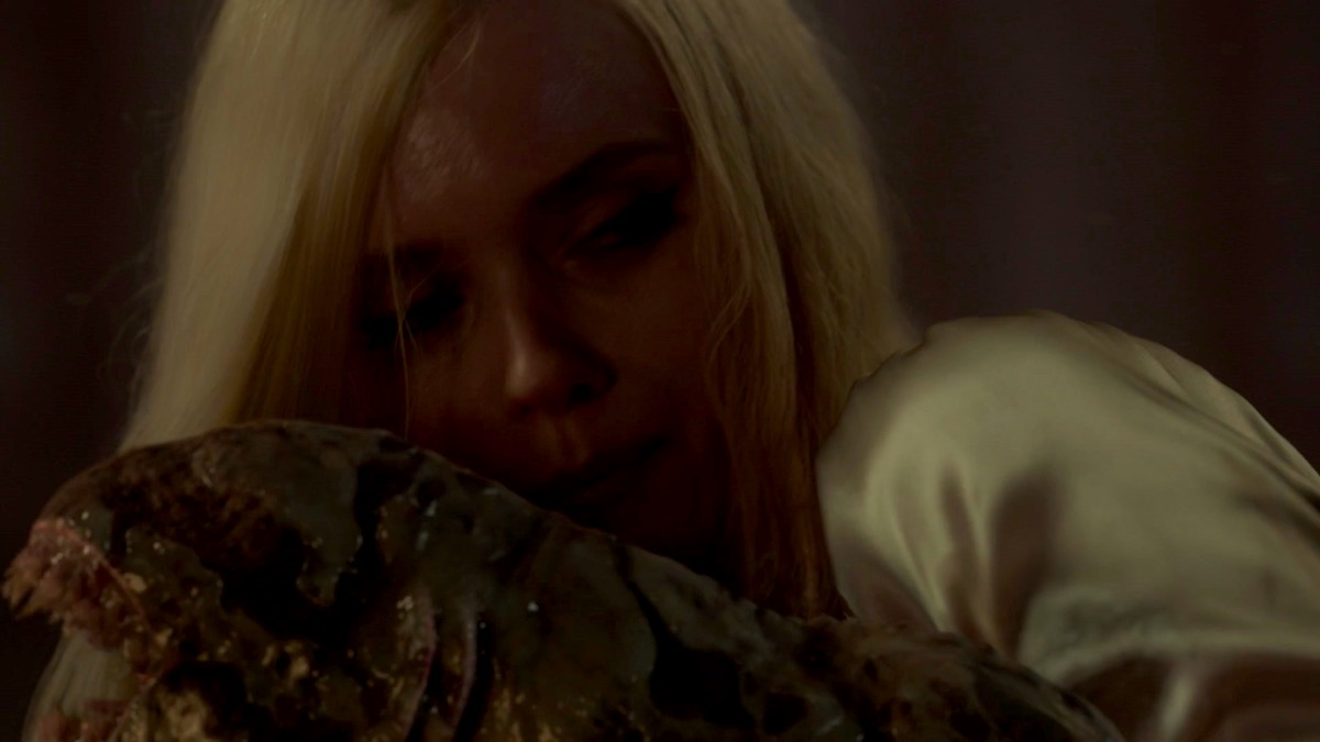 Christina and a newborn sloggoth in LOVECRAFT COUNTRY 1x02