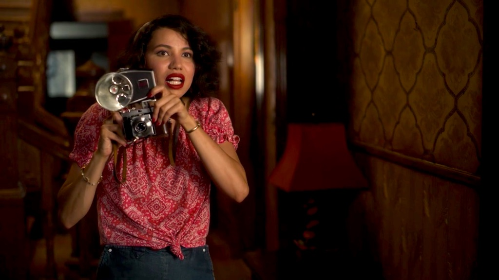Leti and her camera in LOVECRAFT COUNTRY 1x03