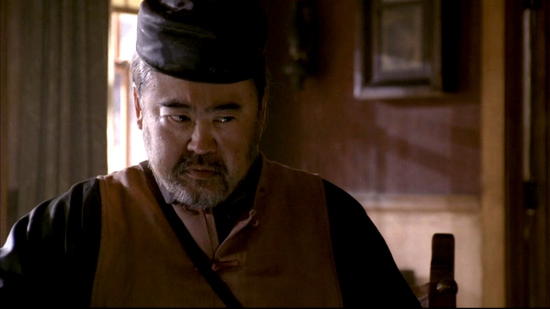 Keone Young as Mister Wu in DEADWOOD 1x10