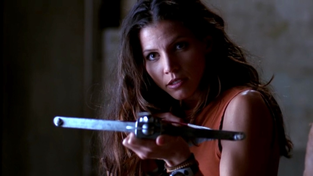 Charisma Carpenter as Cordelia aims a crossbow in ANGEL